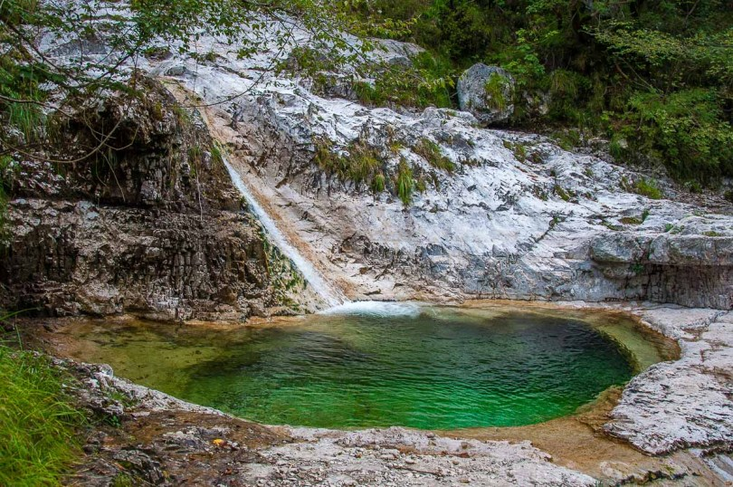 One of the 15 pools with the waterfal feeding it - Cadini del Brenton - Dolomites, Italy - rossiwrites.com