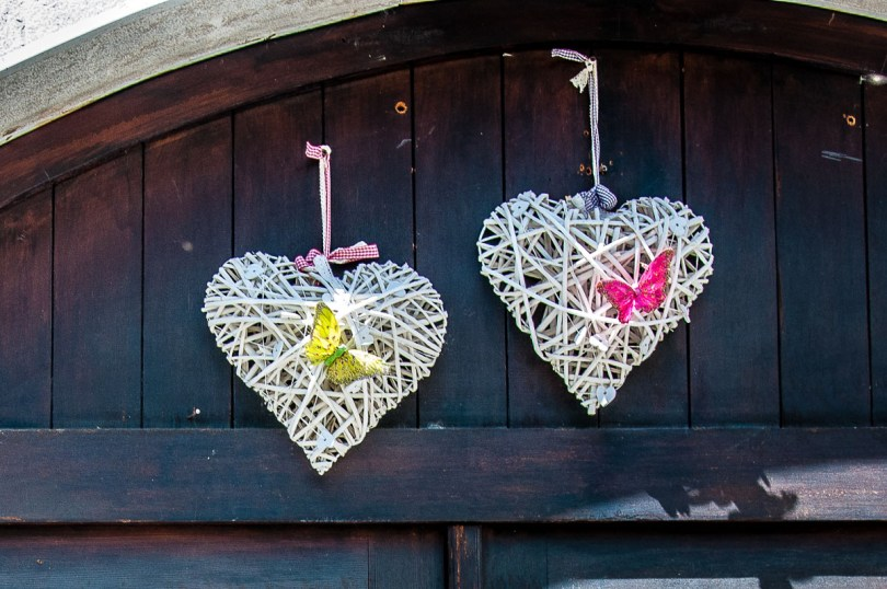 Two hearts adorning the gate of an old house - Venzone, Italy - rossiwrites.com