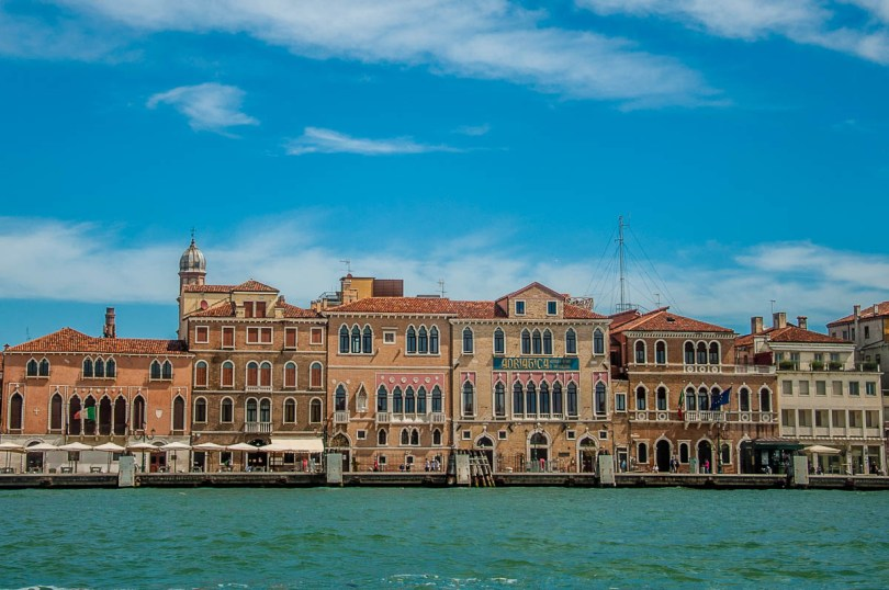 Colourful houses on the Fondamenta delle Zattere glimpsed from the window of the ferry - Venice, Italy - rossiwrites.com