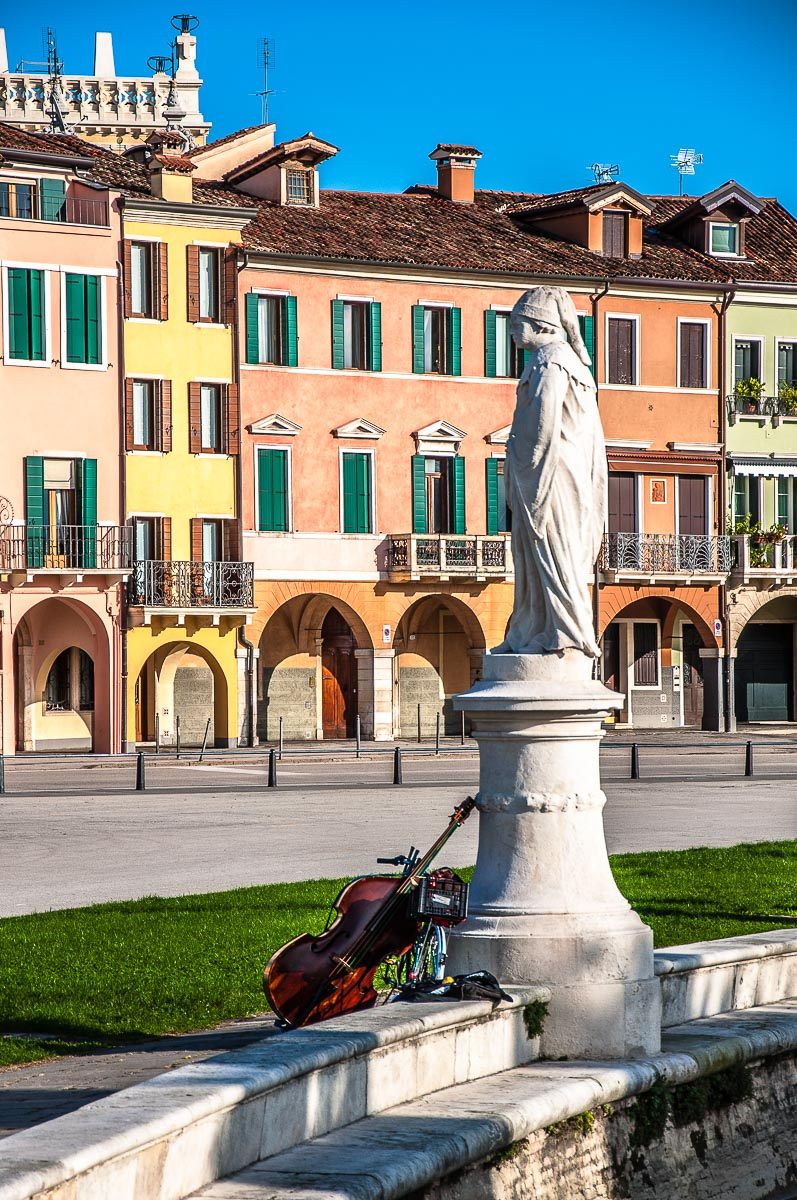 Violoncello by a statue on the elliptical canal of Prato della Valle - Padua, Italy - rossiwrites.com
