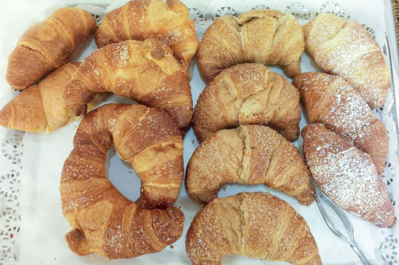 A tray of brioches with different fillings served for breakfast in Italy - rossiwrites.com