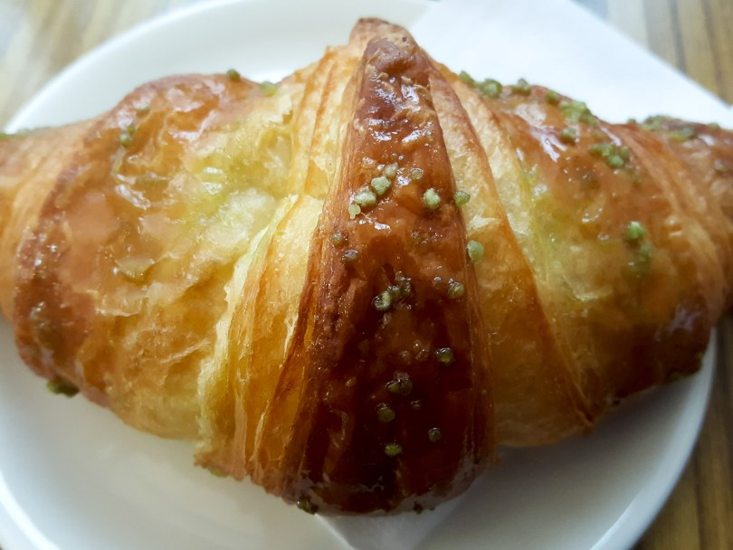Close-up of a brioche with pistacchio spread - Vicenza, Italy - rossiwrites.com