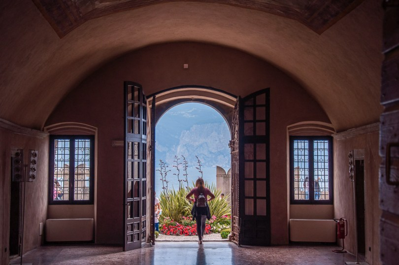 The ground floor hall of the Palazzo dei Capitani with the large door open to the garden - Malcesine, Italy - rossiwrites.com