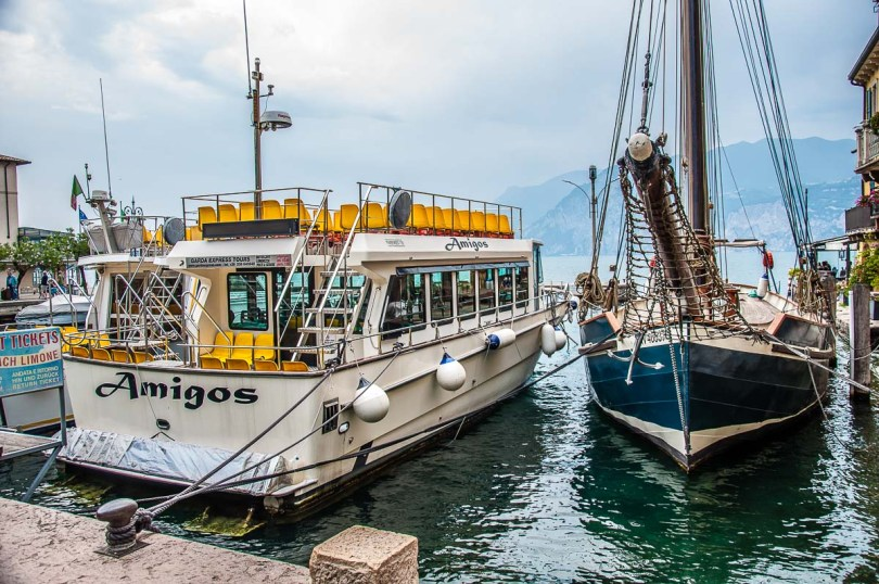 Tourist boats in the harbour in the historic centre with a view of Lake Garda - Malcesine, Italy - rossiwrites.com