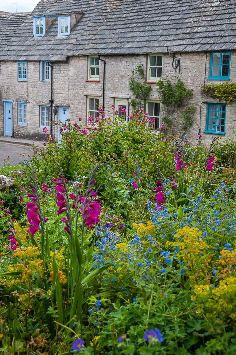 A gorgeous garden and traditional stone cottages in the village of Worth Matravers - Dorset, England - rossiwrites.com
