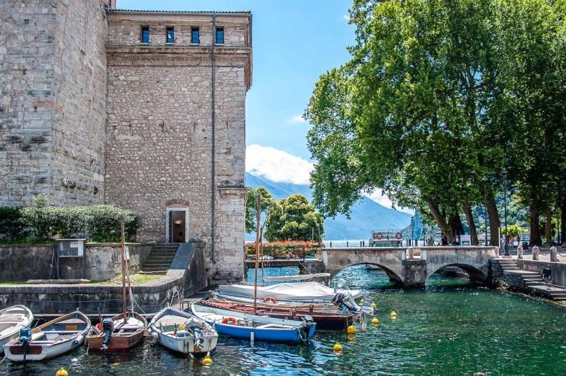 The fortress Rocca di Garda with boats and views of Lake Garda - Riva del Garda, Italy - rossiwrites.com