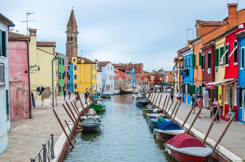 Colourful houses flanking a canal with boats - Burano - Venice, Italy - rossiwrites.com