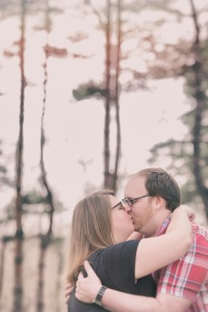 couple kissing engagement photos