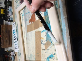Painting the Gesso on the frame