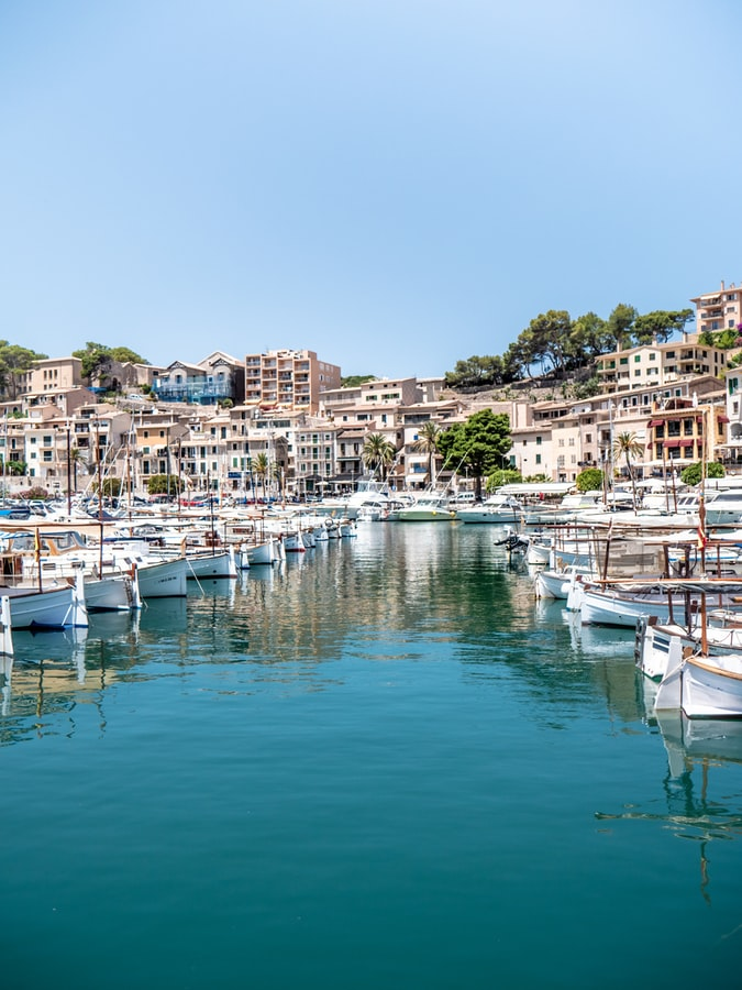a white villages with harbour on the spain island mallorca
