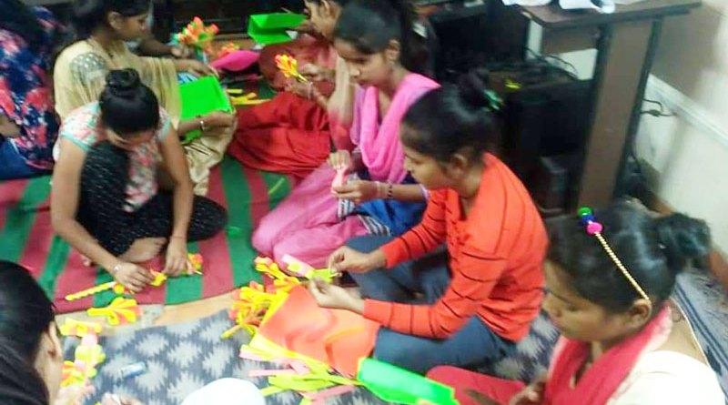 Children at the Basti Vikas Kendra learn the art of making decorative items.