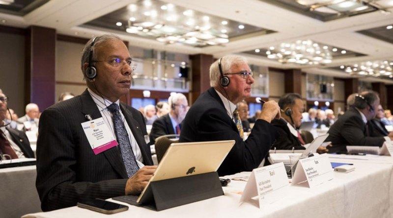 PRIPs K R Ravindran and Ian Riseley listen to representatives debating a proposal at the CoL.