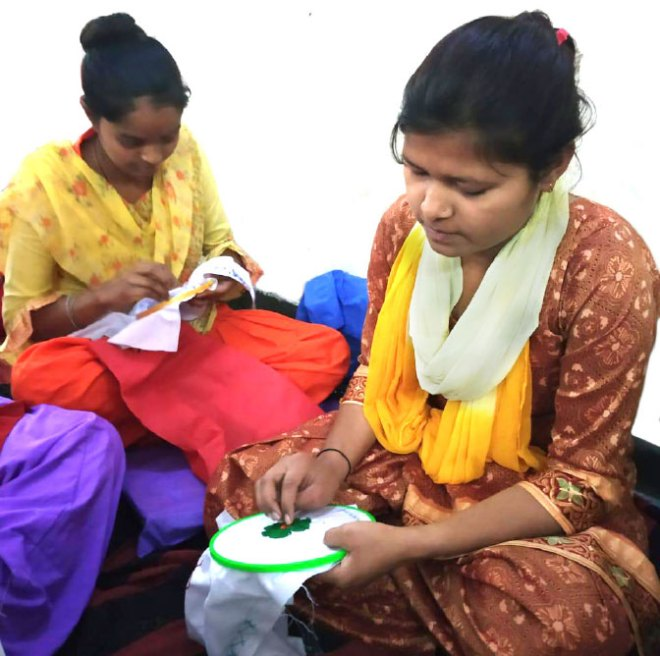 Women learning embroidery.