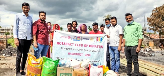 Rotaractors with grocery items and essentials for seven families who were victims of a fire mishap.