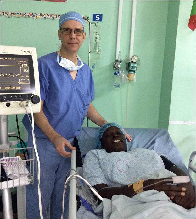 Dr. John Strasswimmer, Member of the Rotary Club of Boca Raton, visiting his patient post-operative in St George's Hospital, Grenada