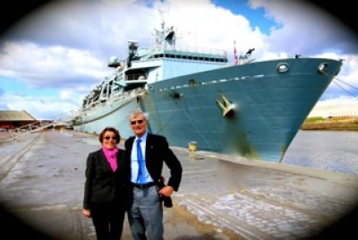 Geoff & Jan on the quey with HMS Bulwark