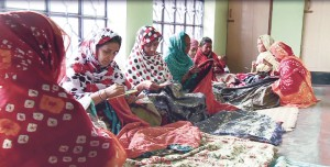 A typical adda of Kantha workers.