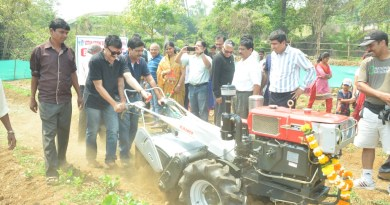 Rotarians operate the power tiller donated to the Sansthan.