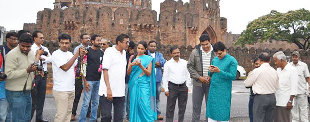 Deputy Commissioner Dr P C Jaffer and visitors at the Bidar Fort read about the monument on Wikipedia.