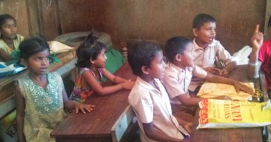 Assamese children reciting rhymes in school.