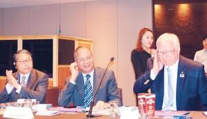 From left: PRID Sang Koo Yun, RI President K R Ravindran and TRF Trustee Ian Riseley listen to translation of the seminar proceedings.
