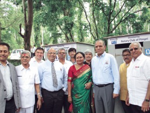 RI President Ravindran, spouse Vanathy and RI Director Manoj Desai inaugurating toilet block at Panshet school.