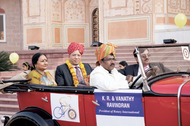 RI President K R Ravindran and spouse Vanathy arrive at the inaugural of the Rotary Institute in a vintage car.