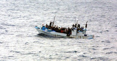 Refugees on a boat.