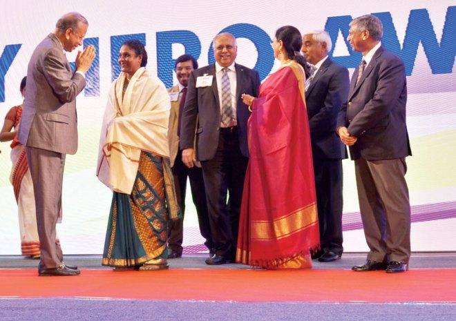 From left: RI President K R Ravindran, PDG Anil Agarwal, RID Manoj Desai and Sharmishtha Desai, PDG Ramesh Chander and PRID Y P Das greet a Literacy Hero awardee, Larzy Verghese.