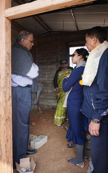 RI President K R Ravindran is briefed by Bushita of VFC, as spouse Vanathy and DG Keshav Kunwar look on.