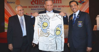 RI President K R Ravindran displaying the batik shirt in the presence of RID Manoj Desai and DG Chandu Agarwal.