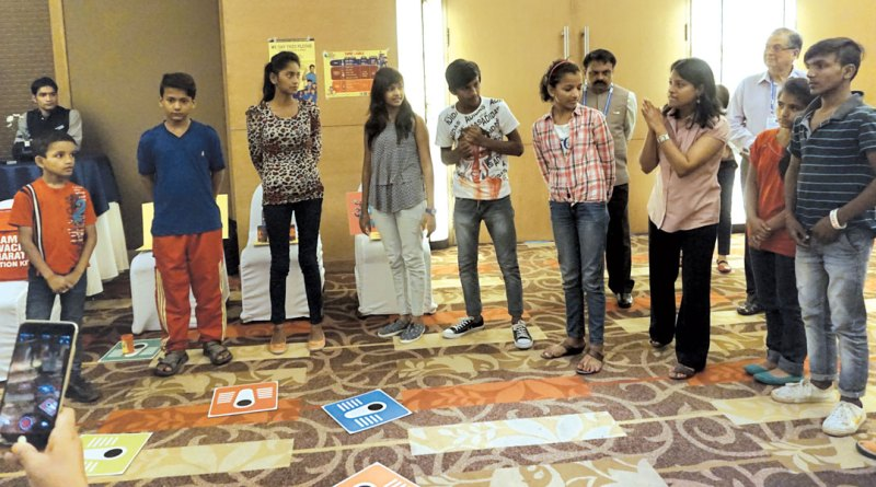 Children enact a short skit to explain WinS.