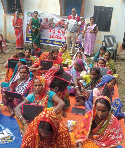 An adult literacy session conducted by RC Bokaro Steel City, D 3250.