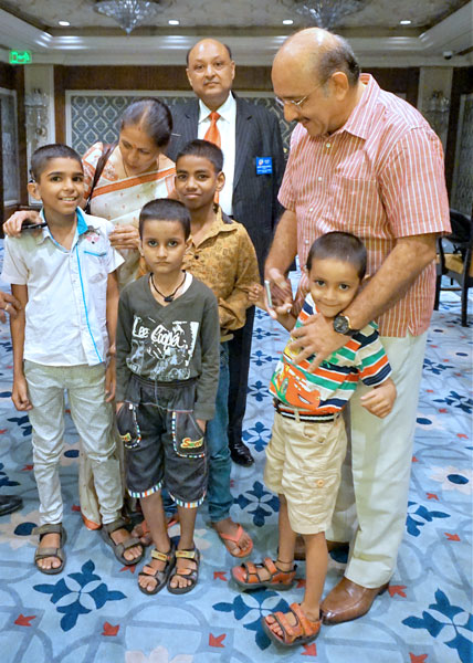 From right: Dr J M Hans and RC Delhi Riverside President G P Agarwal with children fitted with cochlear implants.