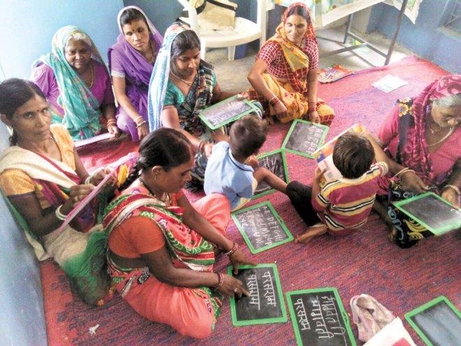 An adult literacy programme in progress.