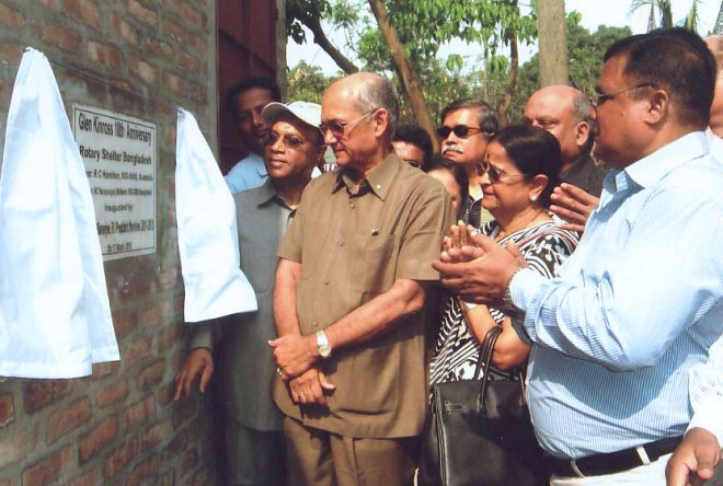 PRIP Kalyan Banerjee and Binota Banerjee examining the low cost houses built in Bangladesh to honour PRIP Glen Kinross's 10 years of service after his presidential year.
