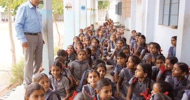 PDG Mohan Shah with schoolchildren at Nirona village.