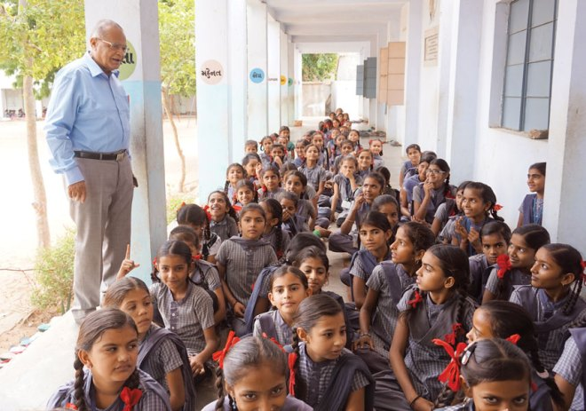 PDG Mohan Shah with schoolchildren at Nirona village.