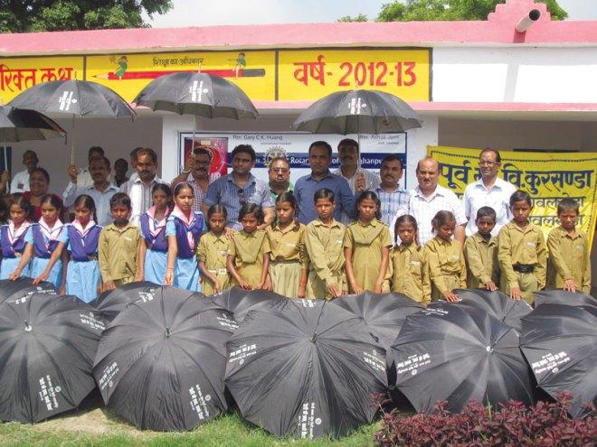 RC Shajahanpur City RI District 3110 Umbrellas were donated to 150 underprivileged students of Purva Madhyamik Vidhyalaya at Kursanda village.