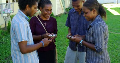 donot-bound_apr15_Group_of_young_people_texting_on_mobile_phones