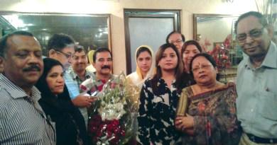 Kolkata Rotarians welcome Gulalai (head covered) and her parents.