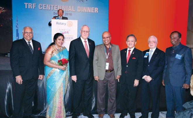 RID Manoj Desai, Sindhu Jayantha Kumar, RI President John Germ, Rtn Jayantha Kumar, PRIP Gary Huang, TRF Trustee Sushil Gupta and Institute Chair Raja Seenivasan. RRFC Kamal Sanghvi is in this background.