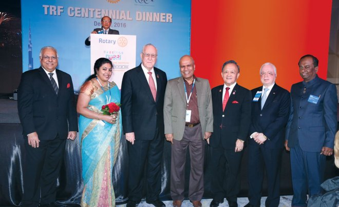 RID Manoj Desai, Sindhu Jayantha Kumar, RI President John Germ, Rtn Jayantha Kumar, PRIP Gary Huang, TRF Trustee Sushil Gupta and Institute Chair Raja Seenivasan. RRFC Kamal Sanghvi is in this background.