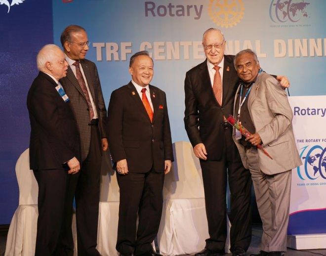 RI President John Germ honouring AKS member Harshad Mehta in the presence of TRF Trustee Sushil Gupta, IPRIP K R Ravindran and PRIP Gary Huang.