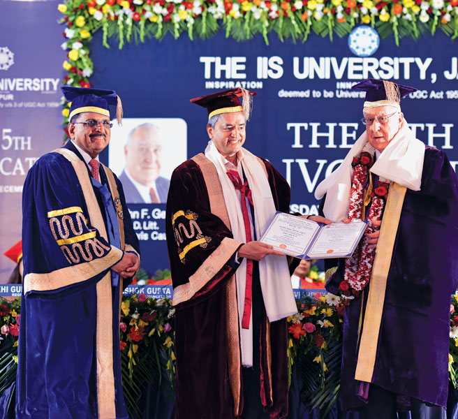 (From R) RI President John Germ receives a doctorate conferred on him by the IIS University, from Cardiac Surgeon Devi Shetty, as University Vice Chancellor and PDG Ashok Gupta looks on.