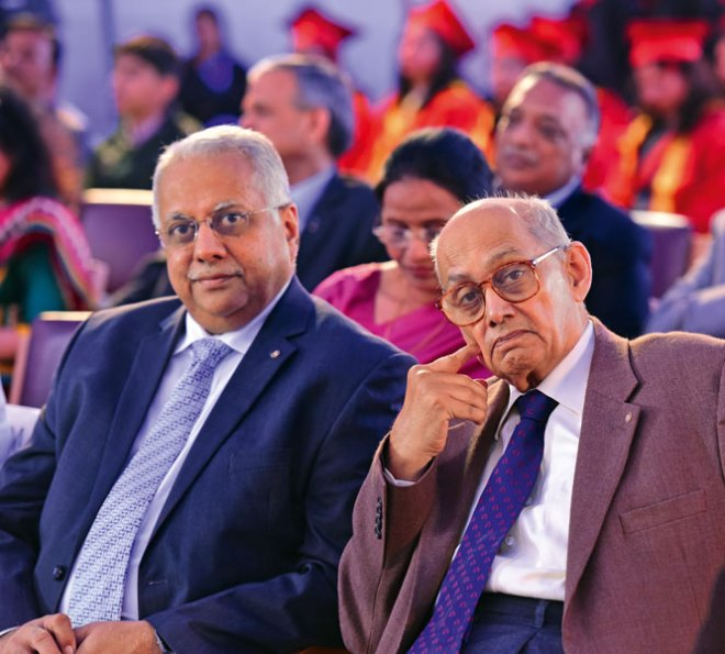 TRF Trustee Chair Kalyan Banerjee (right) with RI Director Manoj Desai.