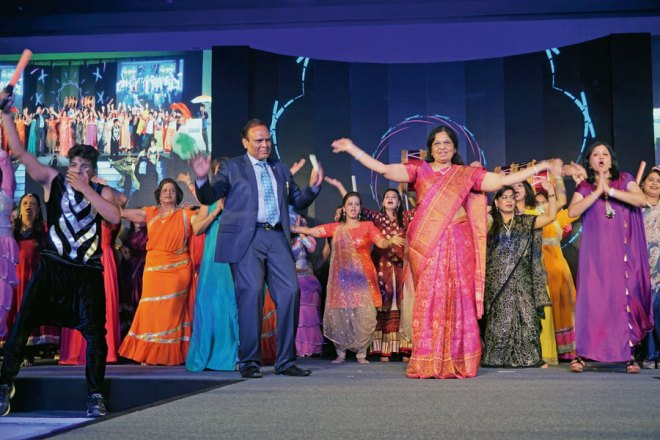 DG Gopal Mandhania joins First Lady of the District Meera and other spouses for a Bollywood dance session.