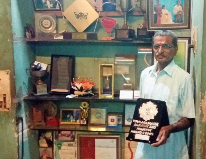 Bipin Ganatra at his home with his numerous awards he had received in honour of his services.