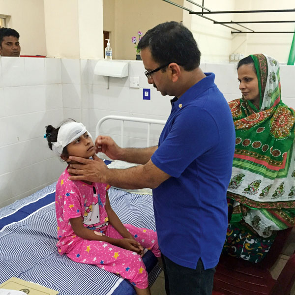 Dr Vikrant Mathur treating a child at the ENT camp.