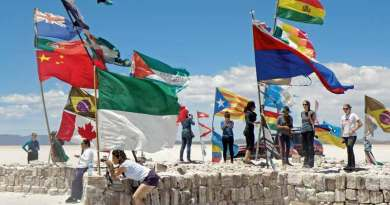 Flags from across the globe flutter on a platform of salt bricks.